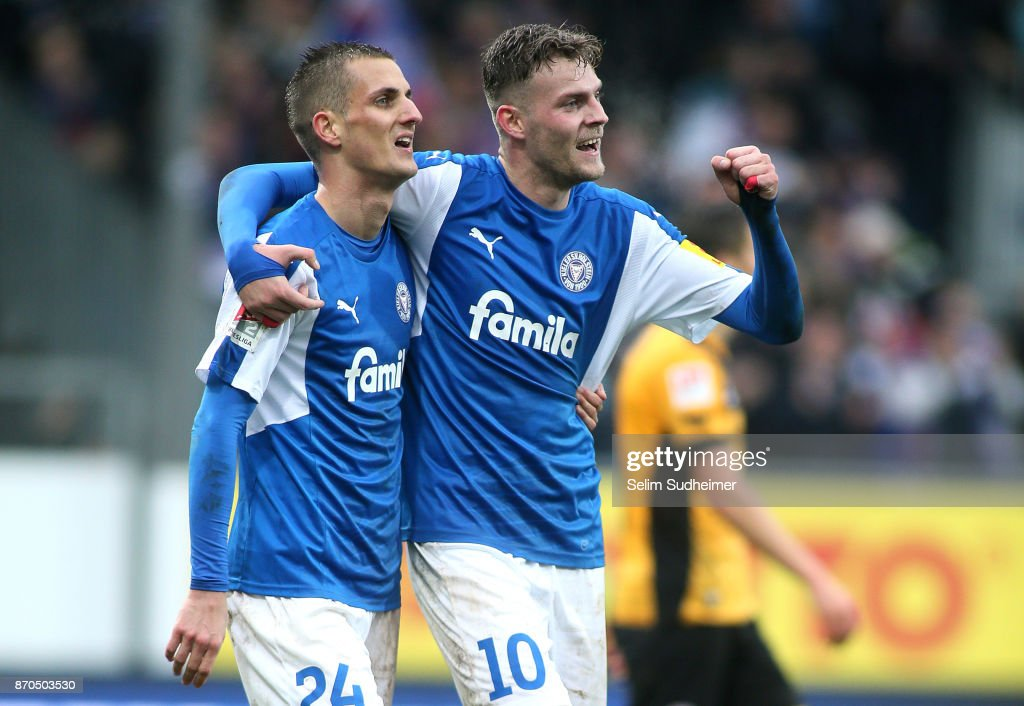 Dominick Drexler (L) and Marvin Ducksch of Holstein Kiel celebrate their teams second goal scoring during the Second Bundesliga match between Holstein Kiel and SG Dynamo Dresden at Holstein-Stadion on November 5, 2017 in Kiel, Germany.