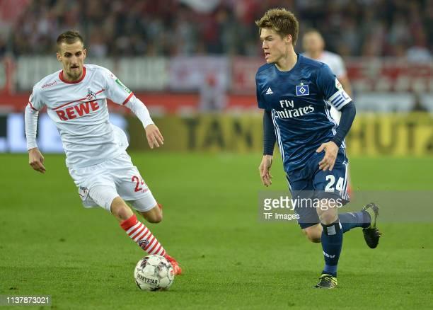 Dominick Drexler of 1 FC Koeln and Gotoku Sakai of Hamburger SV battle for the ball during the Second Bundesliga match between 1 FC Koeln and...
