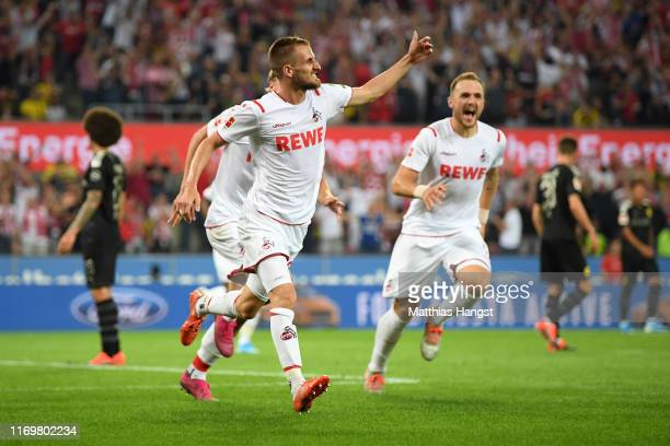 Dominick Drexler of 1 FC Koeln celebrates scoring his side's first goal during the Bundesliga match between 1 FC Koeln and Borussia Dortmund at...
