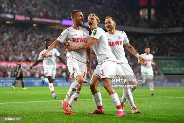Dominick Drexler of 1. FC Koeln celebrates with his team mates after scoring his side's first goal during the Bundesliga match between 1. FC Koeln...