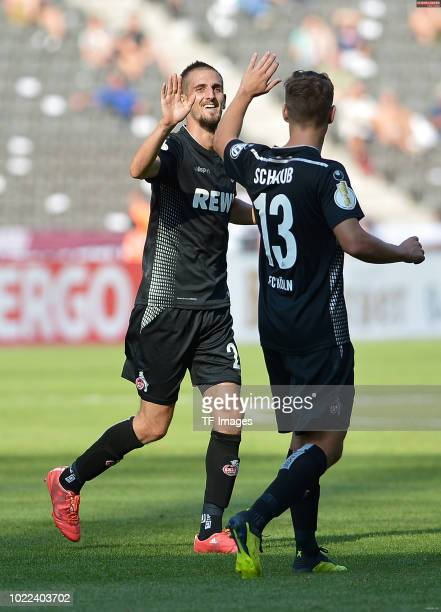 Dominick Drexler of FC Koeln celebrates after scoring his team`s seventh goal with Louis Schaub of FC Koeln during the DFB Cup first round match...