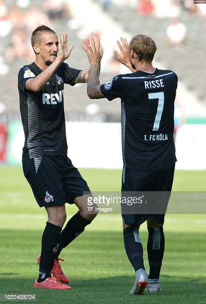 Dominick Drexler of FC Koeln celebrates after scoring his team`s seventh goal with Marcel Risse of FC Koeln during the DFB Cup first round match...