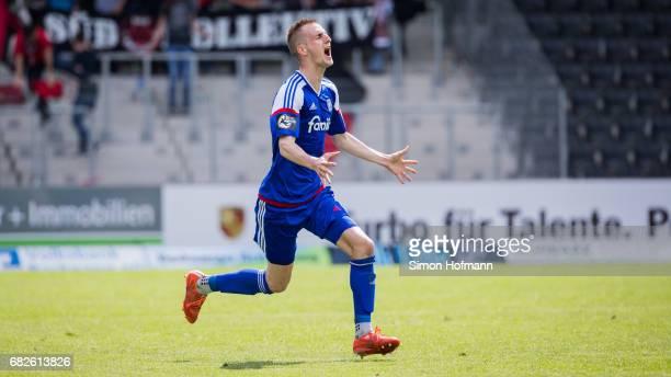 Dominick Drexler of Kiel celebrates winning at the final whistle during the 3 Liga match between Sonnenhof Grossaspach and Holstein Kiel at...