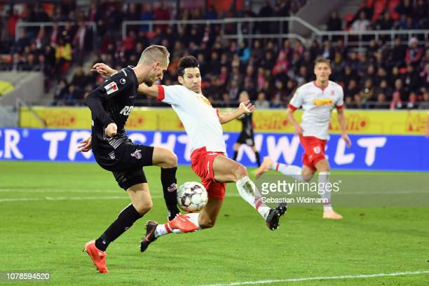 Dominick Drexler of Koeln scores his teams second goal against Marcel Correia of Regensburg during the Second Bundesliga match between SSV Jahn...