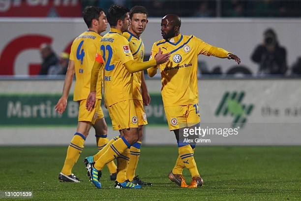 Dominick Kumbela of Braunschweig celebrates his team's first goal with team mates during the Second Bundesliga match between Greuther Fuerth and...