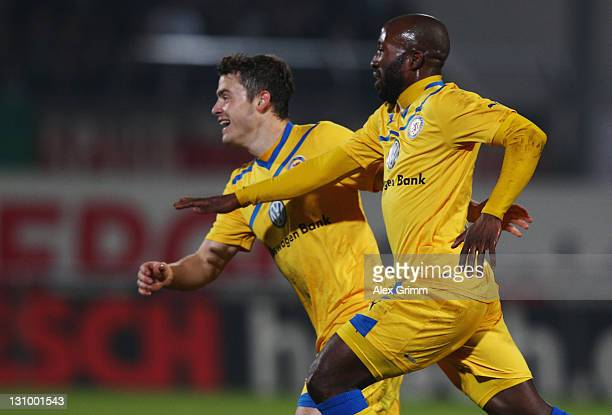 Dominick Kumbela of Braunschweig celebrates his team's first goal with team mate Oliver Petersch during the Second Bundesliga match between Greuther...
