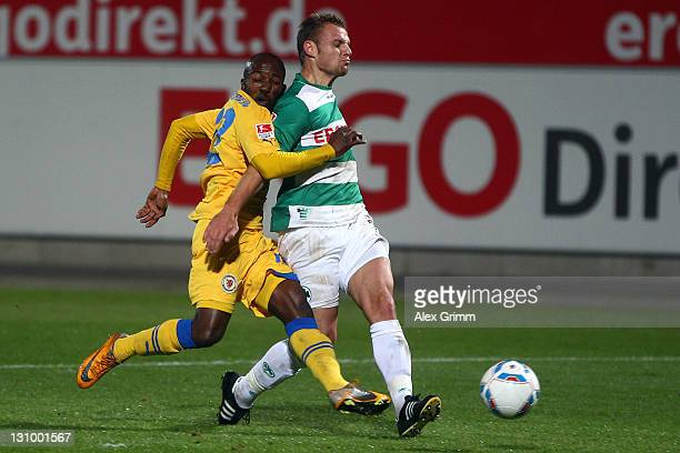 Dominick Kumbela of Braunschweig scores his team's first goal against Bernd Nehrig of Greuther Fuerth during the Second Bundesliga match between...