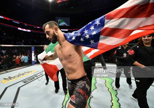 Dominick Reyes celebrates after his TKO victory over Chris Weidman in their light heavyweight bout during the UFC Fight Night event at TD Garden on...