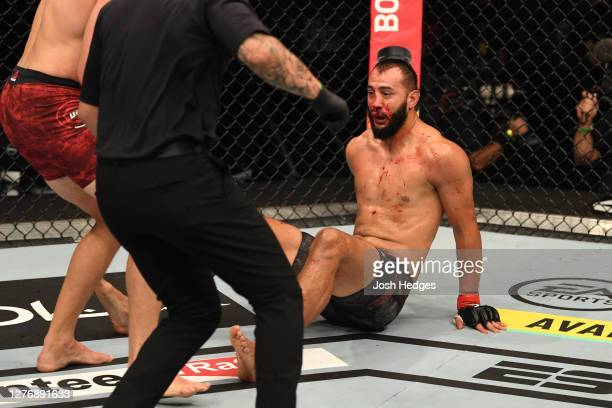 Dominick Reyes is knocked down to the mat by Jan Blachowicz of Poland in their light heavyweight championship bout during UFC 253 inside Flash Forum...
