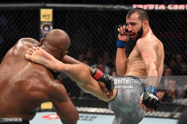 Dominick Reyes kicks Jon Jones in their light heavyweight championship bout during the UFC 247 event at Toyota Center on February 08 2020 in Houston...