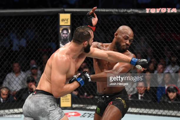 Dominick Reyes punches Jon Jones in their light heavyweight championship bout during the UFC 247 event at Toyota Center on February 08 2020 in...