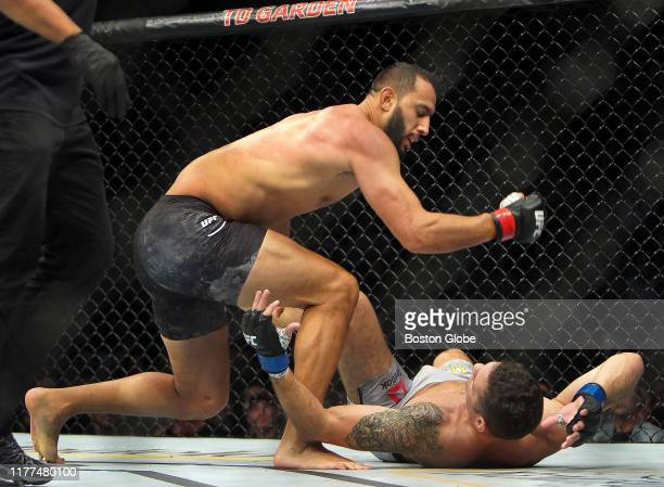 Dominick Reyes rains hammer fists down on Chris Weidman moments before the fight was stopped in a Light Heavyweight Main Event bout during the UFC...