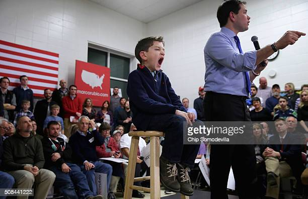 Dominick Rubio joins his father Republican presidential candidate Sen Marco Rubio on stage during a campaign town hall event at Mary A Fisk...