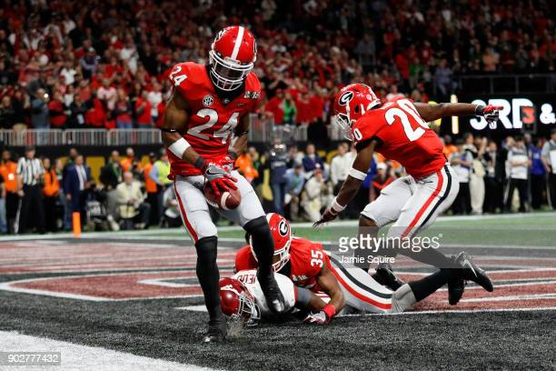 Dominick Sanders of the Georgia Bulldogs fails to make an interception in bounds after breaking up a touchdown pass intended for Jerry Jeudy of the...