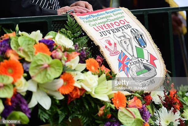 Dominico Di Bernardo a Juventus fan present during the Heysel tragedy holds the match banner as he pays his respects to the victims during a ceremony...