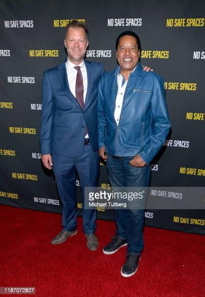 Dominik Andrzejczuk and Larry Elder attend the premiere of the film No Safe Spaces at TCL Chinese Theatre on November 11 2019 in Hollywood California