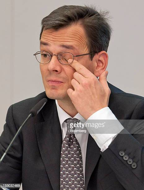 Dominik Asam chief financial officer of Infineon Technologies AG wipes his eye during a news conference in Munich Germany on Wednesday Nov 16 2011...