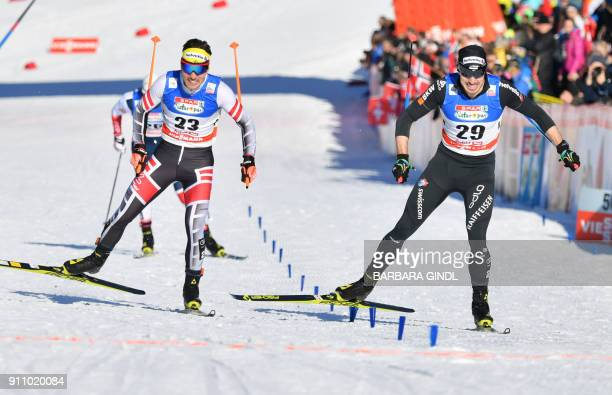 Dominik Baldauf of Austria and Gianluca Cologna of Switzerland compete during the men's sprint of the FIS cross country world cup in Seefeld Austria...
