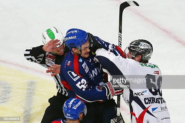 Dominik Bittner of Mannheim and Mads Christensen of Berlin fight during the DEL match between Adler Mannheim and Eisbaeren Berlin at SAP Arena on...