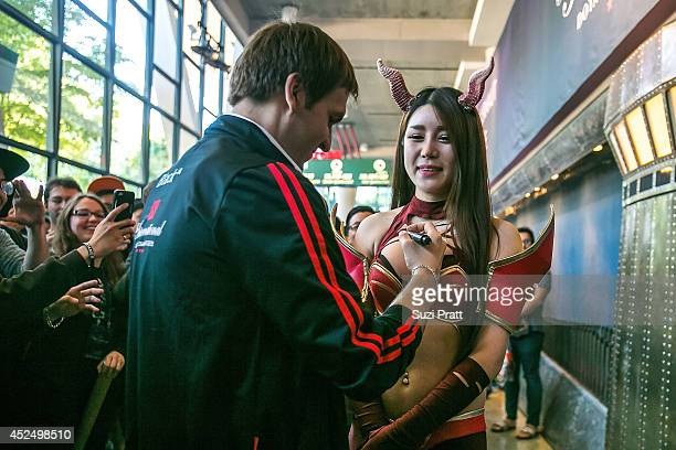 Dominik 'Black ^' Reitmeier signs his autograph on a fan's chest at The International DOTA 2 Championships at Key Arena on July 21 2014 in Seattle...