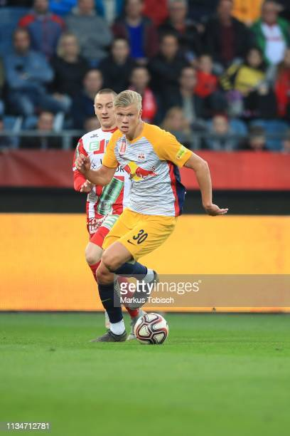 Dominik Derrant of Grazer AK competes for the ball with Erling Braut Haland of RB Salzburg during the UNIQA OeFB Cup Semifinal match between Grazer...