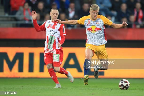 Dominik Derrant of Grazer AK competes for the ball withErling Braut Haland of RB Salzburg during the UNIQA OeFB Cup Semifinal match between Grazer AK...