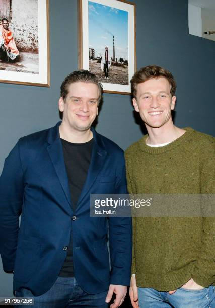 Dominik Elstner and German actor Artjom Gilz during the exhibition opening 'PortrAid Get art Give work' at DRIVE Volkswagen Group Forum on February...