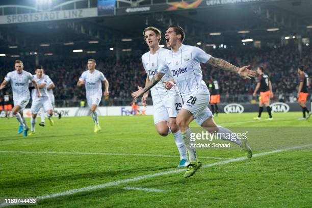 Dominik Frieser celebrates with Marko Raguz both of Linzer ASK after scoring on the goal for 2:1 during the UEFA Europa League group D match between...
