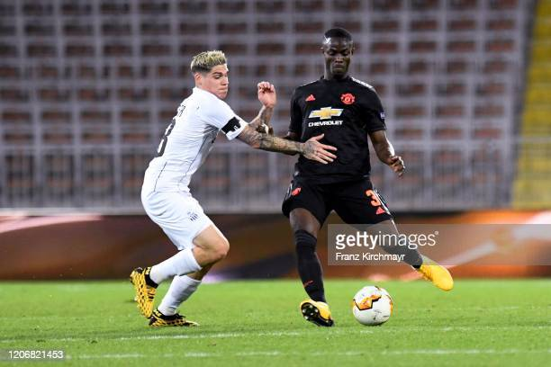 Dominik Frieser of LASK competes for the ball with Eric Bailly of Manchester United during UEFA Europa League Round of 16 First Leg match between...