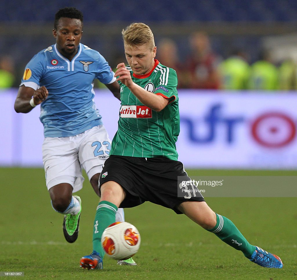 Dominik Furman of Legia Warszawa (R) competes for the ball with Eddy Onazi of SS lazio during the Uefa Europa League Group J match between SS Lazio and Legia Warszawa at Stadio Olimpico on September 19, 2013 in Rome, Italy.