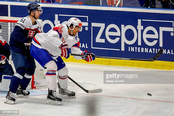Dominik Granak of Slovakia and Andreas Martinsen of Norway battle for the puck during the IIHF World Championship group B match between Slovakia and...