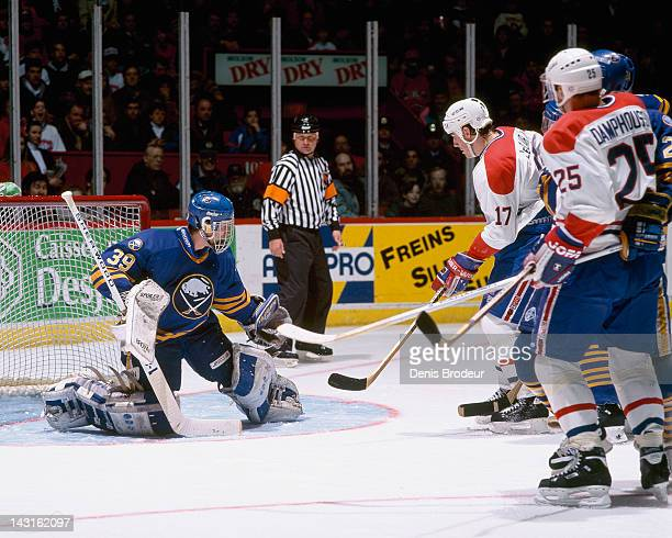 Dominik Hasek of the Buffalo Sabres makes a save on John LeClair of the Montreal Canadiens during a game Circa 1995 at the Montreal Forum in Montreal...