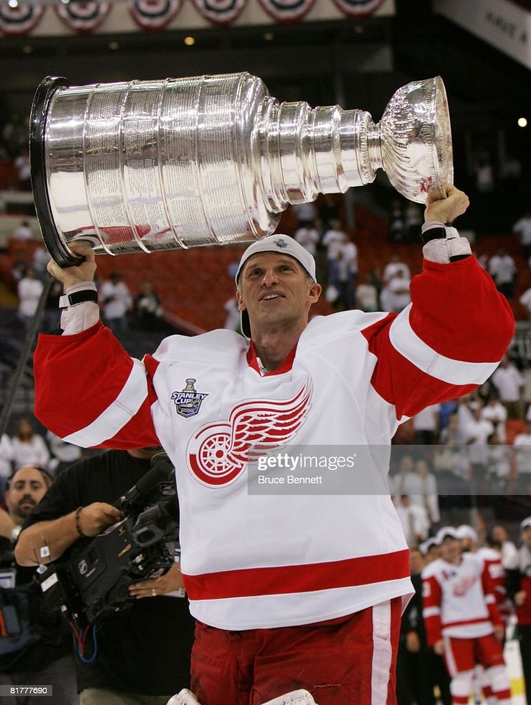 Dominik Hasek #39 of the Detroit Red Wings celebrates with the Stanley Cup after defeating the Pittsburgh Penguins in game six of the 2008 NHL Stanley Cup Finals at Mellon Arena on June 4, 2008 in Pittsburgh. Pennsylvania. The Red Wings defeated the Penguins 3-2 to win the Stanley Cup Finals 4 games to 2.