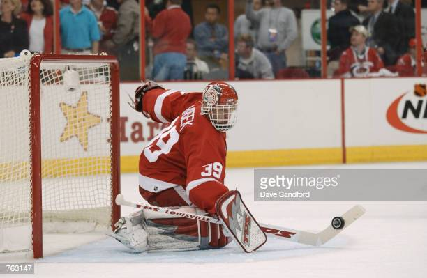 Dominik Hasek of the Detroit Red Wings makes a save shot by the Carolina Hurricanes during game 4 of the NHL Stanley Cup Finals on June 10, 2002 at...