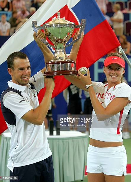 Dominik Hrbaty and Daniela Hantuchova of the Slovakia pose after winning the 2005 Hopman Cup at the Burswood Dome on January 8, 2005 in Perth,...
