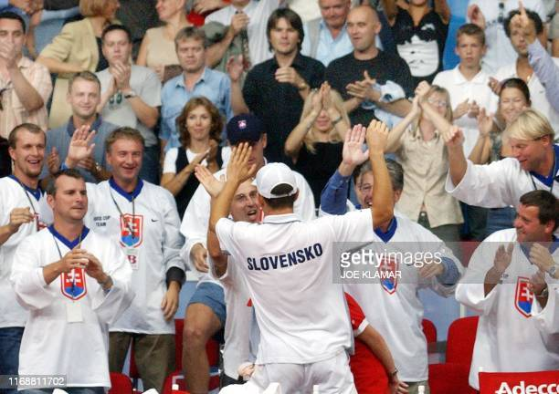 Dominik Hrbaty of Slovakia celebrates with his teammates and fans his victory over US Andy Roddick of US in the Davis cup World group playoff match...