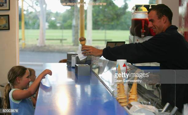 Dominik Hrbaty of the Slovak Republic enjoys a visit to an ice cream store during day one of the Australian Open Grand Slam at Melbourne Park January...