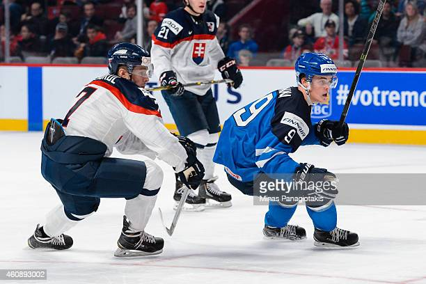 Dominik Jendrol of Team Slovakia and Julius Honka of Team Finland skate during the 2015 IIHF World Junior Hockey Championship game at the Bell Centre...