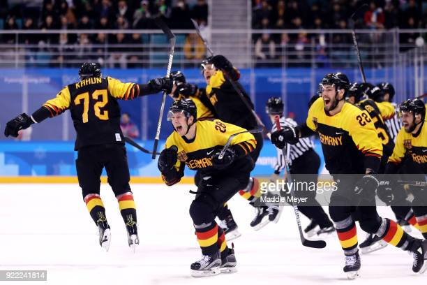 Dominik Kahun Frank Mauer and Matthias Plachta of Germany celebrate after defeating Sweden 43 during the Men's Playoffs Quarterfinals game on day...