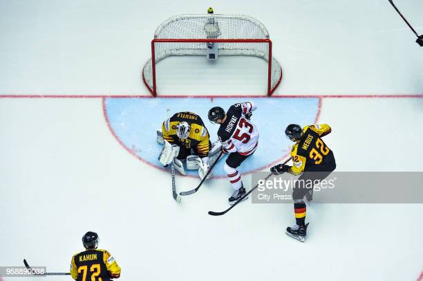Dominik Kahun Niklas Treutle of Team Germany Bo Horvat of Team Canada and Oliver Mebus of Team Germany during the IIHF World Championship game...