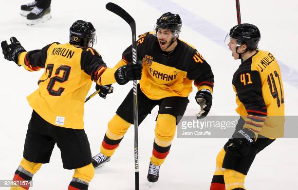 Dominik Kahun of Germany celebrates his goal with Yasin Ehliz Jonas Muller of Germany during the Men's Ice Hockey Gold Medal match between Germany...