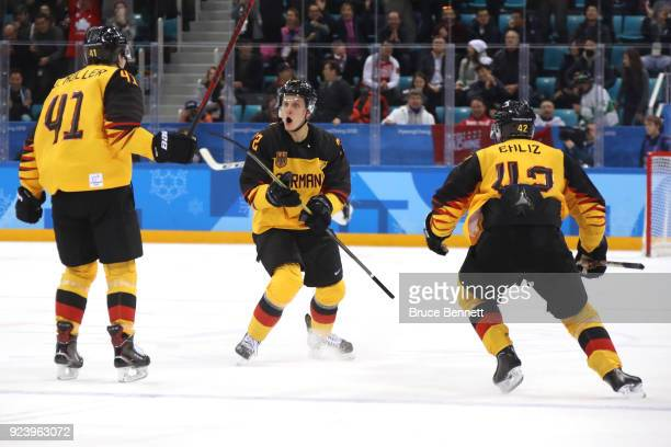 Dominik Kahun of Germany celebrates with Jonas Muller and Yasin Ehliz after scoring a goal in the third period against Olympic Athletes from Russia...