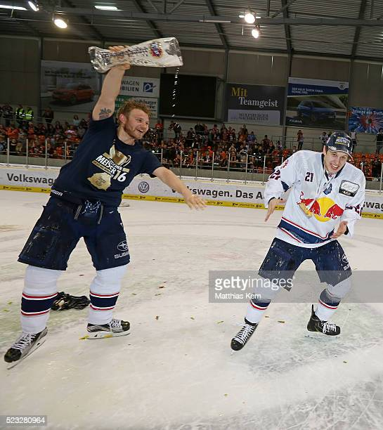 Dominik Kahun of Muenchen gets a beer shower from team mate Mads Christensen after winning the DEL playoffs final game four between Grizzlys...