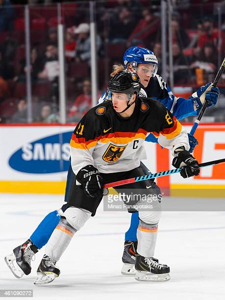 Dominik Kahun of Team Germany skates as Roope Hintz of Team Finland passes behind him in a preliminary round game during the 2015 IIHF World Junior...