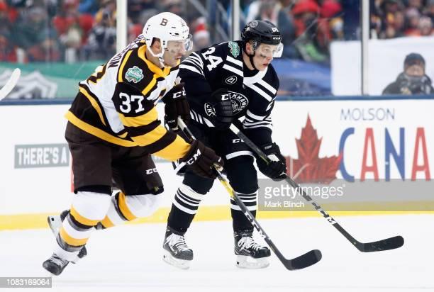 Dominik Kahun of the Chicago Blackhawks and Patrice Bergeron of the Boston  Bruins play in the. 2019 Bridgestone NHL Winter Classic ... c8de0cb66
