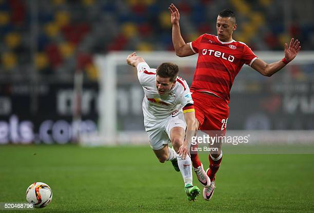 Dominik Kaiser of Leipzig is challenged by Nikola Djurdjic of Duesseldorf during the Second Bundesliga match between Fortuna Duesseldorf and RB...
