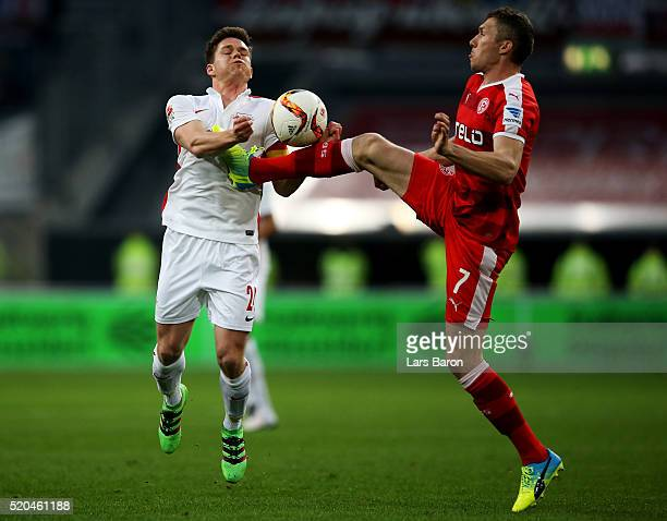 Dominik Kaiser of Leipzig is challenged by Oliver Fink of Duesseldorf during the Second Bundesliga match between Fortuna Duesseldorf and RB Leipzig...