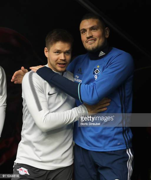Dominik Kaiser of RB Leipzig hugs former Leipzig player Kyriakos Papadopoulos of Hamburger SV prior to the Bundesliga match between RB Leipzig and...