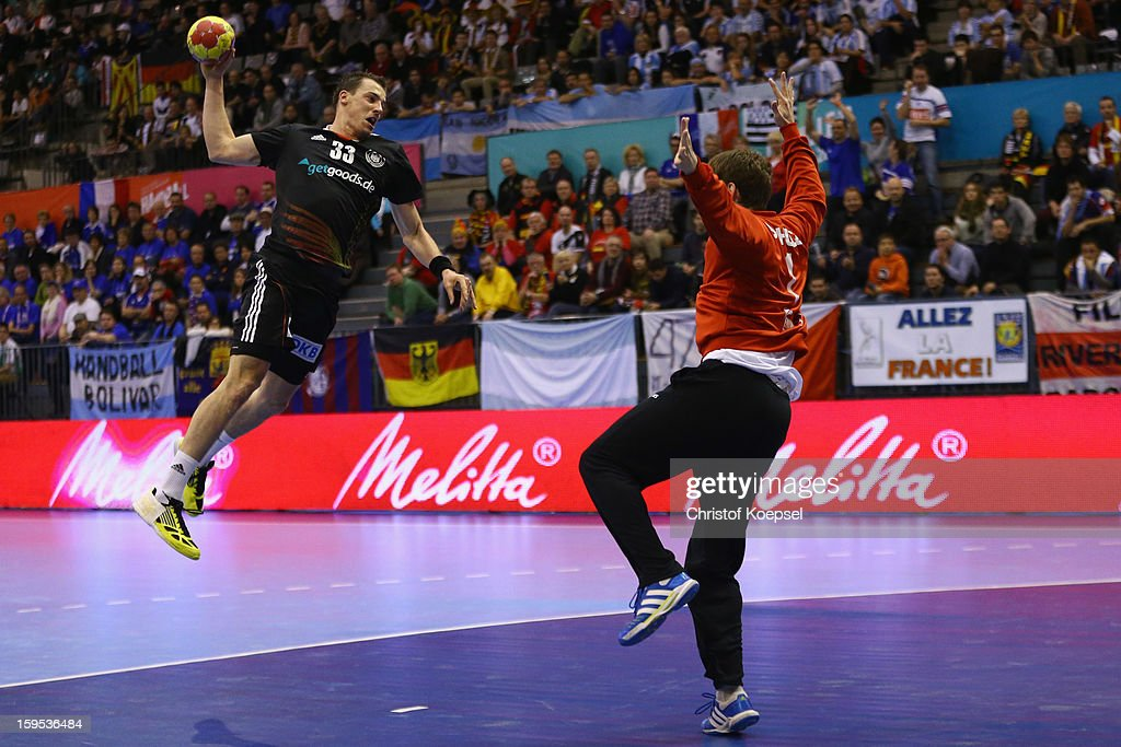 Dominik Klein of Germany scores a goal Matias Schulz of Argentina during the premilary group A match between Germany and Argentina at Palacio de Deportes de Granollers on January 15, 2013 in Granollers, Spain.
