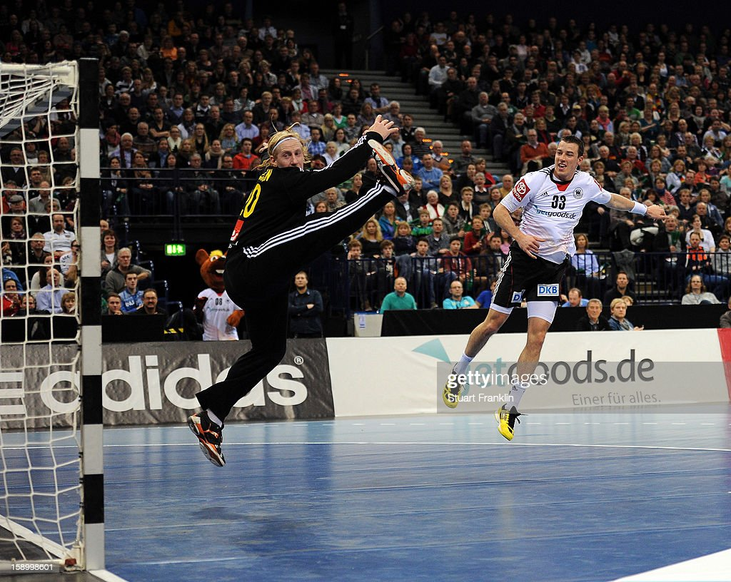 Dominik Klein of Germany throws a goal during the international handball friendly match between Germany and Sweden at O2 World on January 5, 2013 in Hamburg, Germany.